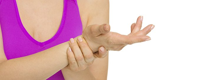 Closeup on woman with wrist pain