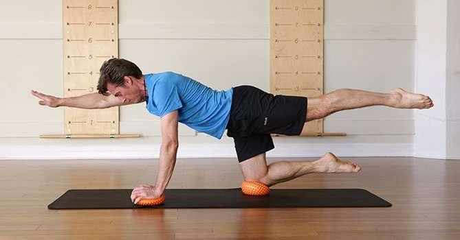 Quadruped arm leg reach on balance pods-ST