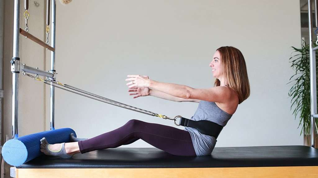 Spinal rotation exercise on Pilates Cadillac